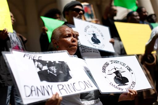 In this April 9, 2014 file photo, family members of inmates who claim they were wrongfully convicted gather to show support as a group of New York City men, who claimed they were framed by a crooked police detective decades ago.