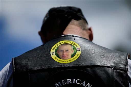 "In this Saturday, June 22, 2013 file photo, Gulf War veteran Ron Coumerilh wears a sticker to support captive U.S. Army Sgt. Bowe Bergdahl at the ""Bring Bowe Back"" celebration in Hailey, Idaho."