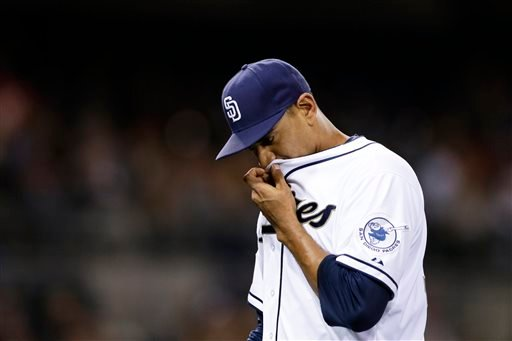 San Diego Padres starting pitcher Tyson Ross wipes his face with his jersey as he walks off the field at the end of the fourth inning while playing the Washington Nationals in a baseball game Friday, June 6, 2014, in San Diego. (AP Photo/Gregory Bull)