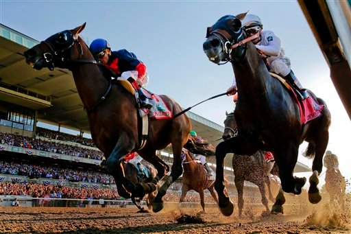 Tonalist, left, with Joel Rosario up edges out Commissioner with Javier Castellano up to win the 146th running of the Belmont Stakes horse race, Saturday, June 7, 2014, in Elmont, N.Y. (AP Photo/Matt Slocum)