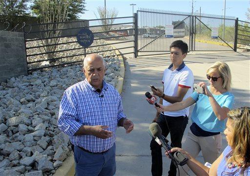 Nogales, Ariz., Mayor Arturo Garino speaks to the media outside the gate of the U.S. Border Patrol facility on Saturday, June 7, 2014, in Nogales, Ariz.