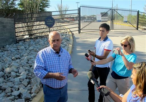 Nogales, Ariz., Mayor Arturo Garino speaks to the media outside the gate of the U.S. Border Patrol facility on Saturday, June 7, 2014, in Nogales, Ariz.