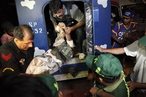 The airport attack still was ongoing early Monday in Karachi, a sprawling port city on the southern coast of Pakistan, although officials said all the passengers had been evacuated. (AP Photo/Shakil Adil)