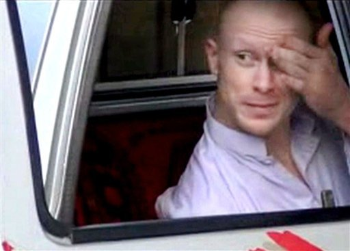 In this file image taken from video obtained from Voice Of Jihad Website, which has been authenticated based on its contents and other AP reporting, Sgt. Bowe Bergdahl, sits in a vehicle guarded by the Taliban in eastern Afghanistan.