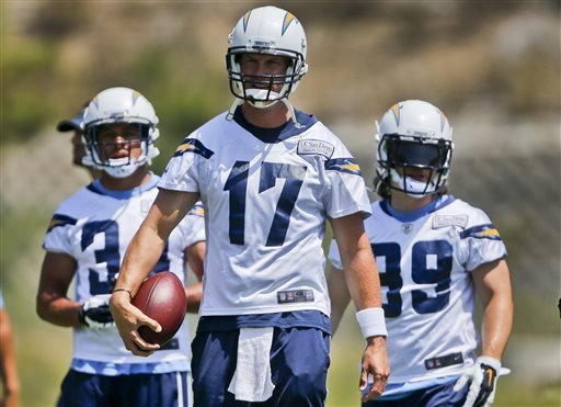 San Diego Chargers quarterback Philip Rivers leads some of his offensive teammates to a drill during an NFL football organized team activity Monday, June 9, 2014, in San Diego.