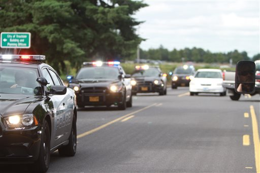 Police officers respond to a shooting at Reynolds High School Tuesday, June 10, 2014, in Troutdale, Ore.