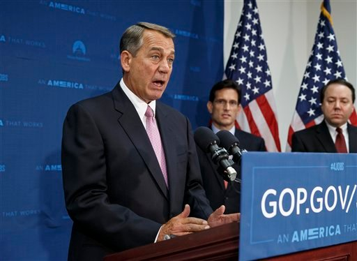 House Speaker John Boehner of Ohio, joined by House Majority Leader Eric Cantor, R-Va., center, and Rep. Pat Tiberi, R-Ohio, talks to reporters on Capitol Hill in Washington, Tuesday, June 10, 2014, after a Republican Conference meeting. (AP)