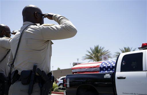 Las Vegas Metropolitan Police officers salute the casket of their fellow officer Igor Soldo outside of Canyon Ridge Christian Church Thursday, June 12, 2014 in Las Vegas. (AP)