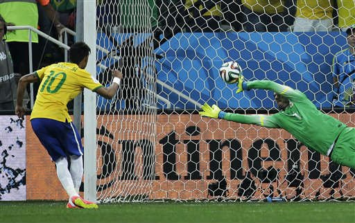 Brazil's Neymar, left, scores his sides second goal from the penalty spot during the group A World Cup soccer match between Brazil and Croatia, the opening game of the tournament, in the Itaquerao Stadium in Sao Paulo, Brazil. (AP)