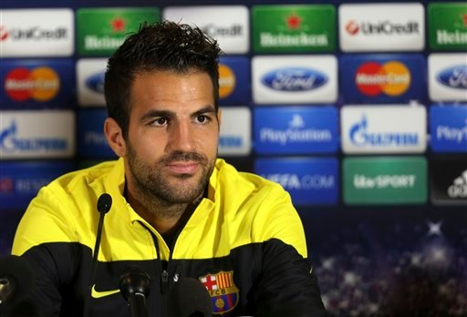 A Monday, Sept. 20, 2013 photo from files showing Barcelona's Cesc Fabregas talking to the media during a press conference at Celtic Park, Glasgow, Scotland.
