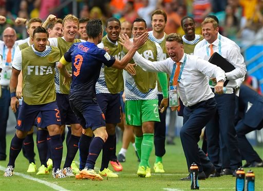 Netherlands' Robin van Persie celebrates with Netherlands' head coach Louis van Gaal after scoring a goal during the group B World Cup soccer match between Spain and the Netherlands at the Arena Ponte Nova in Salvador, Brazil, Friday, June 13, 2014. (AP)