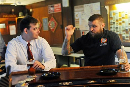 In this photo taken on Thursday, June 12, 2014, former Marine Sgt. Ben Colin, left, and Army veteran Tom Griswald talk about their experiences serving in Iraq at the Sheehy-Palmer VFW Post 6776 in Albany, N.Y. (AP)