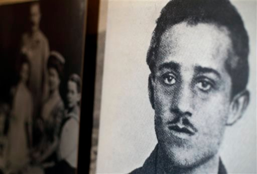 In this photo taken on April 4, 2014, a photo of Gavrilo Princip, the Bosnian-Serb nationalist who, assassinated Archduke Franz Ferdinand is on display at the National World War I Museum in Kansas City, Mo.