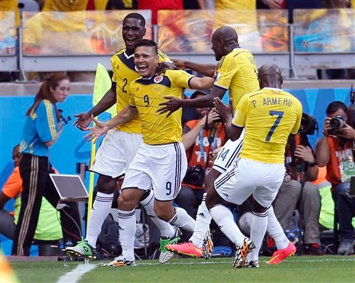 Colombia's Teofilo Gutierrez, centre, celebrates after scoring his side's second goal during the group C World Cup soccer match between Colombia and Greece at the Mineirao Stadium in Belo Horizonte, Brazil, Saturday, June 14, 2014.