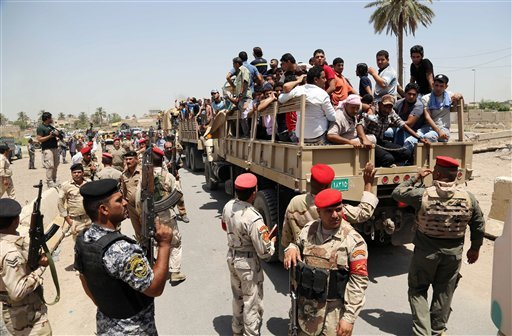 Iraqi men board military trucks to join the Iraqi army at the main recruiting center in Baghdad, Iraq, Saturday, June. 14, 2014, after authorities urged Iraqis to help battle insurgents.