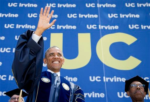 President Barack Obama, left, with University of California, Irvine (UCI) Chancellor Michael Drake, waves to the UCI graduating class at the Angel Stadium of Anaheim in Anaheim, Calif., Saturday, June 14, 2014. (AP Photo/Manuel Balce Ceneta)
