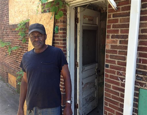 Anthony Brown, 59, stands next to a vacant house adjacent to his home in Detroit's Marygrove neighborhood on Friday, June 13, 2014.