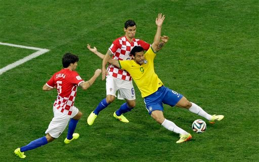 Brazil's Fred, right, falls after making contact with Croatia's Dejan Lovren during the group A World Cup soccer match between Brazil and Croatia, the opening game of the tournament, in the Itaquerao Stadium in Sao Paulo, Brazil, Thursday, June 12, 2014.