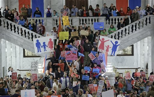 In this Jan 28, 2014 file photo, people protest during a rally for the opponents for gay marriage at the state Capitol in Salt Lake City.