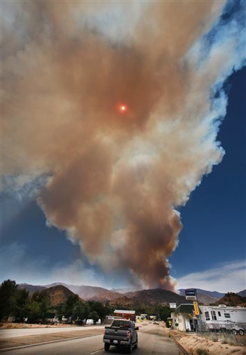 The Shirley Fire kicks up smoke with the sun in the center in Wofford Heights, Calif., Sunday, June 15, 2014.