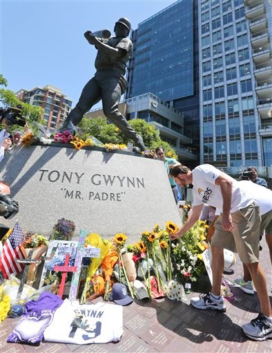 "Members of the San Diego Chargers place flowers at the base of the Tony Gwynn ""Mr. Padre"" statue, Monday, June 16, 2014, in San Diego."