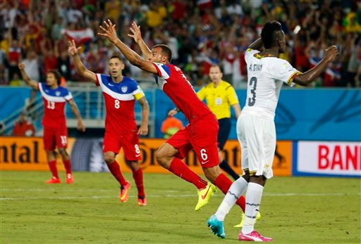 United States' John Brooks (6) celebrates with teammates after scoring his side's second goal during the group G World Cup soccer match between Ghana and the United States at the Arena das Dunas in Natal, Brazil, Monday, June 16, 2014.
