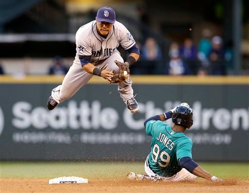 San Diego Padres second baseman Alexi Amarista leaps to get out of the way of sliding Seattle Mariners' James Jones (99) at second base in the fourth inning in a baseball game Monday, June 16, 2014, in Seattle.
