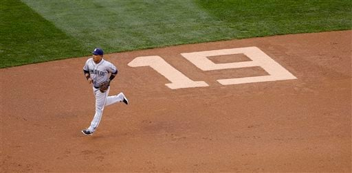 "San Diego Padres shortstop Everth Cabrera runs past a number ""19"" etched into the infield to honor former Padres' Tony Gwynn in the first inning during a baseball game against the Seattle Mariners Monday, June 16, 2014, in Seattle."