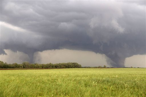 Two tornados approach Pilger, Neb., Monday June 16, 2014. The National Weather Service said at least two twisters touched down within roughly a mile of each other Monday in northeast Nebraska. (AP Photo/Eric Anderson)