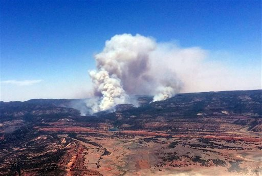 This image provided by Inci Web shows a plume of smoke in the Chuska Mountains near Naschitti, N.M. on Sunday, June 15, 2014.