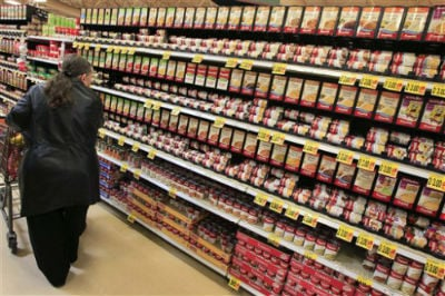 This Feb. 7, 2012 file photo shows a shopper walking down the canned soup aisle at a grocery store in Cincinnati.