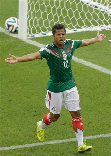 Mexico's Giovani dos Santos reacts after a goal was disallowed during the group A World Cup soccer match between Mexico and Cameroon in the Arena das Dunas in Natal, Brazil, Friday, June 13, 2014. (AP Photo/Hassan Ammar)