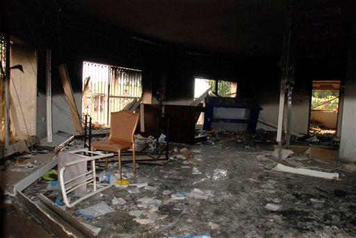 This Sept. 12, 2012 file photo shows glass, debris and overturned furniture are strewn inside a room in the gutted U.S. consulate in Benghazi, Libya, after an attack that killed four Americans, including Ambassador Chris Stevens.
