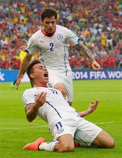 Chile's Eduardo Vargas celebrates after scoring the opening goal during the group B World Cup soccer match.