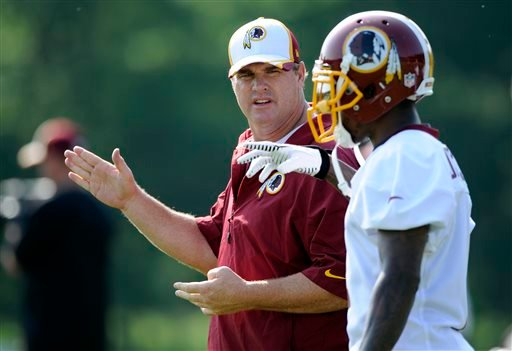 Washington Redskins head coach Jay Gruden, left, talks with wide receiver DeSean Jackson, right, during NFL football minicamp, Wednesday, June 18, 2014, in Ashburn, Va. (AP Photo/Nick Wass)