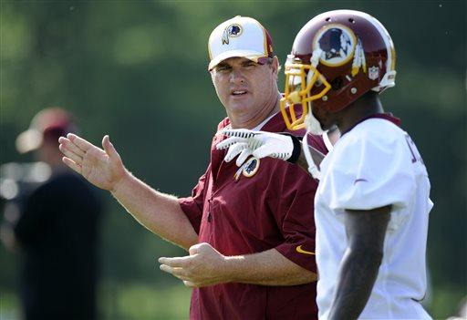 Washington Redskins head coach Jay Gruden, left, talks with wide receiver DeSean Jackson, right, during NFL football minicamp, Wednesday, June 18, 2014, in Ashburn, Va. (AP Photo/Nick Wass)