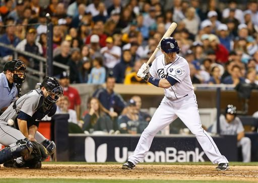 Seattle Mariners catcher Mike Zunino can't handle a wild pitch to San Diego Padres' Chris Denorfia in the sixth inning that allowed the Padres' Alexi Amarista tp score from third and tie the baseball game Wednesday, June 18, 2014, in San Diego.