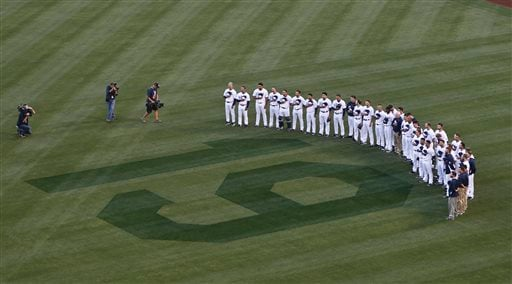 San Diego Padres players stand in right field observing 19 seconds of silence in honor of Hall of Fame player Tony Gwynn during ceremonies prior to a baseball game against the Seattle Mariners.