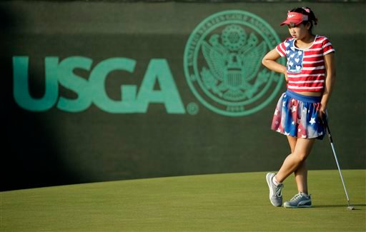 Lucy Li waits to putt on the 13th green during the first round of the U.S. Women's Open golf tournament in Pinehurst, N.C., Thursday, June 19, 2014.
