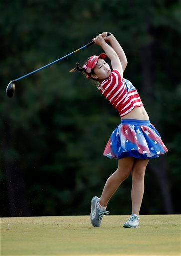 Lucy Li watches her tee shot on the 10th hole during the first round of the U.S. Women's Open golf tournament.