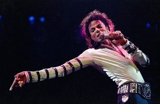 In this Feb. 24, 1988 file photo, Michael Jackson leans, points and sings, dances and struts during the opening performance of his 13-city U.S. tour, in Kansas City, Mo.