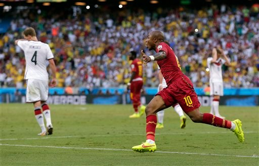 Ghana's Andre Ayew celebrates after scoring his sides' first goal during the group G World Cup soccer match between Germany and Ghana at the Arena Castelao in Fortaleza, Brazil, Saturday, June 21, 2014. (AP Photo/Marcio Jose Sanchez)