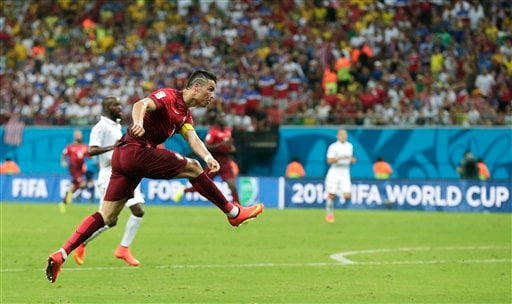 Portugal's Cristiano Ronaldo takes a shot during the group G World Cup soccer match between the United States and Portugal at the Arena da Amazonia in Manaus, Brazil, Sunday, June 22, 2014. (AP Photo/Marcio Jose Sanchez)