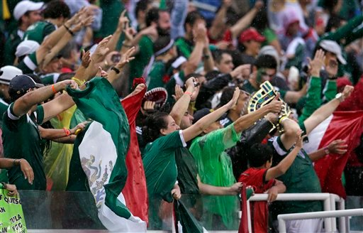 Mexican fans celebrate after their team's 1-0 victory over Cameroon during the group A World Cup soccer match between Mexico and Cameroon in the Arena das Dunas in Natal, Brazil, Friday, June 13, 2014. (AP Photo/Petr David Josek)