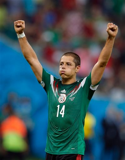 Mexico's Javier Hernandez celebrates at the end of the group A World Cup soccer match between Croatia and Mexico at the Arena Pernambuco in Recife, Brazil, Monday, June 23, 2014. Mexico won 3-1. (AP Photo/Eduardo Verdugo)