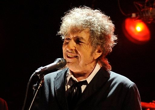 """In this Jan. 12, 2012 file photo, Bob Dylan performs in Los Angeles. One of the most popular songs of all time, Dylan's """"Like a Rolling Stone,"""" could bring between $1 million and $2 million at auction."""