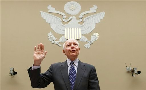 Internal Revenue Service Commissioner John Koskinen is sworn in before the House Oversight Committee as lawmakers continue their probe of whether tea party groups were improperly targeted for increased scrutiny by the IRS, on Capitol Hill in Washington.
