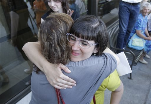 Kate Kelly receives a hug from a supporter after walking to the Church Office Building of the Church of Jesus Christ of Latter-day Saints Sunday, June 22, 2014, in Salt Lake City.