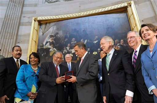 House Speaker John Boehner of Ohio, presents Lonnie Bunch III with a Congressional Gold Medal in honor of the late Dr. and Mrs. Martin Luther King, Jr., who were instrumental in the passage of the Civil Rights Act of 1964. (AP)