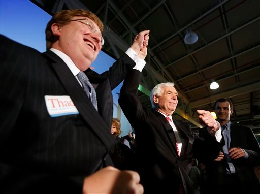U.S. Sen. Thad Cochran, R-Miss., right, and Lt. Gov. Tate Reeves celebrate Cochran's runoff election win over state Sen. Chris McDaniel of Ellisville, in the primary runoff for the GOP nomination for senate June 24, 2014. (AP Photo/Rogelio V. Solis)